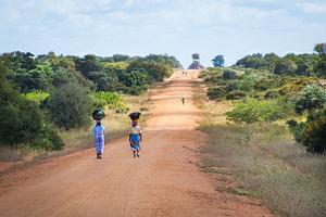 african women walking along road, sand road to mapai, african scene